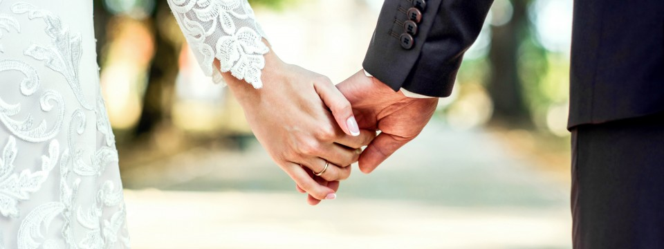 Closeup,View,Of,Married,Couple,Holding,Hands