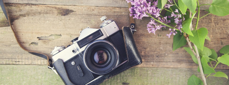 Lilac,And,Camera,On,Wooden,Table