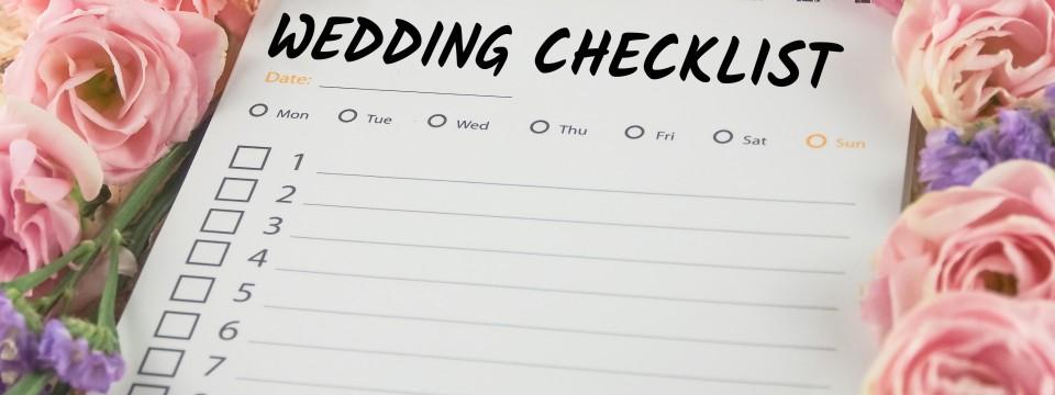 Word,Wedding,Checklist,Note,Paper,On,Pink,Flower,Background