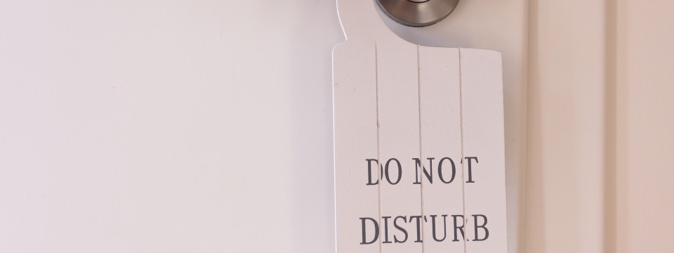 White,Do,Not,Disturb,Sign,Hanging,Decoratively,On,A,Restroom